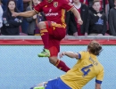 Michael Mangum | Special to the Tribune Real Salt Lake defender Tony Beltran (2) leaps over a sliding Colorado Rapids defender Marc Burch (4) during their match at Rio Tinto Stadium in Sandy, UT on Saturday, April 9, 2016. RSL won 1-0.
