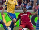 Michael Mangum  |  Special to the Tribune  Real Salt Lake defender Aaron Maund (21) tackles the ball away from Colorado Rapids forward Shkelzen Gashi (11) during the first half their match at Rio Tinto Stadium in Sandy, UT on Saturday, April 9, 2016.