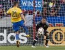 Michael Mangum  |  Special to the Tribune  Real Salt Lake goalkeeper Nick Rimando (18) snatches up the ball in front of an onrushing Colorado Rapids forward Luis Solignac (21) during the first half their match at Rio Tinto Stadium in Sandy, UT on Saturday, April 9, 2016.