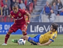 Michael Mangum  |  Special to the Tribune  Real Salt Lake forward Joao Plata (10) avoids a slide tackle from Colorado Rapids defender Eric Miller (3) during the first half their match at Rio Tinto Stadium in Sandy, UT on Saturday, April 9, 2016.