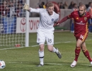 Michael Mangum  |  Special to the Tribune  Real Salt Lake forward Yura Movsisyan (14) pressures Colorado Rapids goalkeeper Zac MacMath (18) at the 6-yard box line during the second half their match at Rio Tinto Stadium in Sandy, UT on Saturday, April 9, 2016. RSL won 1-0.
