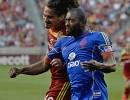 Colorado Rapids defender Marvell Wynne (22) and Real Salt Lake forward Devon Sandoval (49) battle for a header during their match at Rio Tinto Stadium in Sandy, UT on Saturday, May 17, 2014. Real Salt Lake defeated Colorado 2-1.
