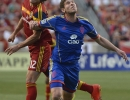 Real Salt Lake midfielder Cole Grossman (12) and Colorado Rapids midfielder Dillon Powers (8) battle for a header during their match at Rio Tinto Stadium in Sandy, UT on Saturday, May 17, 2014. Real Salt Lake defeated Colorado 2-1.
