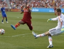 Colorado Rapids goalkeeper Clint Irwin (1) clears the ball out of the box in front of a charging Real Salt Lake forward Joao Plata (8) during their match at Rio Tinto Stadium in Sandy, UT on Saturday, May 17, 2014. Real Salt Lake defeated Colorado 2-1.