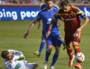 Real Salt Lake forward Devon Sandoval (49), right, earns a penalty kick while being fouled by Colorado Rapids defender Drew Moor (3), center, while Colorado goalkeeper Clint Irwin dives to try and make a block during their match at Rio Tinto Stadium in Sandy, UT on Saturday, May 17, 2014. Real Salt Lake defeated Colorado 2-1.