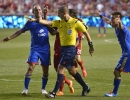 Referee Mark Geiger points to the spot after Real Salt Lake earned a penalty kick in the second half of the match at Rio Tinto Stadium in Sandy, UT on Saturday, May 17, 2014. Colorado Rapids midfielder Nick LaBrocca (2), left,, and midfielder Dillon Serna (17) argue the call. Real Salt Lake defeated Colorado 2-1.