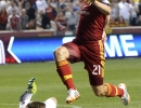 Real Salt Lake midfielder Luis Gil (21) leaps over Colorado Rapids goalkeeper Clint Irwin (1) after a breakaway play during their match at Rio Tinto Stadium in Sandy, UT on Saturday, May 17, 2014. Real Salt Lake defeated Colorado 2-1.