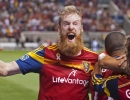 Real Salt Lake centerback Nat Borchers celebrates with his team following Alvaro Saborio's game-winning goal during the their match against FC Dallas at Rio Tinto Stadium in Sandy, UT on Saturday, September 6, 2014. RSL won 2-1.  Michael Mangum  |  ChangingMyLens.com