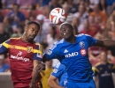 Real Salt Lake forward Robbie Findley (10), left, and Montreal Impact defender Hassoun Camara (6) battle in the air for a 50/50 ball during the second half of their match at Rio Tinto Stadium in Sandy, UT on Thursday, July 24, 2014. Real Salt Lake defeated Montreal 3-1.  Michael Mangum  |  ChangingMyLens.com