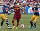 Real Salt Lake midfielder Javier Morales (11), center, fends off New York Red Bulls midfielders Tim Cahill (17), right, and Dax McCarty (11) during the first half of their match at Rio Tinto Stadium in Sandy, UT on Wednesday, July 30, 2014. The match ended in a 1-1 draw.  Michael Mangum  |  ChangingMyLens.com