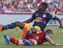New York Red Bulls midfielder Abroise Oyongo (3) falls on top of Real Salt Lake defender Nat Borchers (6) after Borchers deflected his shot during the first half of their match at Rio Tinto Stadium in Sandy, UT on Wednesday, July 30, 2014. The match ended in a 1-1 draw.  Michael Mangum  |  ChangingMyLens.com
