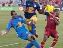 New York Red Bulls defender Jamison Olave (4), center, collides with goalkeeper Luis Robles (31), left, and Real Salt Lake forward Joao Plata (8) during a breakaway for Plata during the second half of their match at Rio Tinto Stadium in Sandy, UT on Wednesday, July 30, 2014. The match ended in a 1-1 draw.  Michael Mangum  |  ChangingMyLens.com