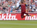 Real Salt Lake forward Olmes Garcia (13) flies through the air while attempting to head the ball during the second half of their match against the New York Red Bulls at Rio Tinto Stadium in Sandy, UT on Wednesday, July 30, 2014. The match ended in a 1-1 draw.  Michael Mangum  |  ChangingMyLens.com