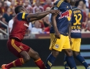 New York Red Bulls defender Jamison Olave (4), right, tangles with Real Salt Lake forward Olmes Garcia (13) during the second half of their match at Rio Tinto Stadium in Sandy, UT on Wednesday, July 30, 2014. In a controversial moment, Garcia was shown a yellow card for diving. The match ended in a 1-1 draw.  Michael Mangum  |  ChangingMyLens.com