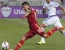 Michael Mangum  |  Special to the Tribune  Real Salt Lake midfielder Javier Morales (11) winds up for a shot as Orlando City SC defender Seb Hines (3) looks on during the first half of their match at Rio Tinto Stadium on Saturday, July 4, 2015. The match ended in a 1-1 draw.