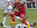 Michael Mangum  |  Special to the Tribune  Real Salt Lake forward Sebastian Jaime (23) leaps over a sliding Orlando City SC midfielder Cristian Higuita (7) during the first half of their match at Rio Tinto Stadium on Saturday, July 4, 2015.