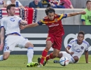 Michael Mangum  |  Special to the Tribune  Real Salt Lake defender Tony Beltran (2) drives passed Orlando City SC defender Luke Boden (14), left, and midfielder Cristian Higuita (7) during the first half of their match against Orlando City FC at Rio Tinto Stadium on Saturday, July 4, 2015.