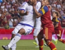 Michael Mangum  |  Special to the Tribune  Orlando City SC midfielder Cristian Higuita (7) and Real Salt Lake forward Joao Plata (8) get tangled up near the box during the second half of their match at Rio Tinto Stadium on Saturday, July 4, 2015. The match ended on a 1-1 draw.