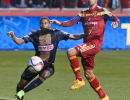Real Salt Lake forward Sebastian Jaime (23) battles for possession with Philadelphia Union defender Raymon Gaddis (28) during their match at Rio Tinto Stadium in Sandy, UT on Saturday, March 14, 2015. The match ended in a 3-3 draw.