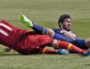 Philadelphia Union defender Sheanon Williams (25) falls on top of Real Salt Lake midfielder Javier Morales (11) as he slides for the ball during their match at Rio Tinto Stadium in Sandy, UT on Saturday, March 14, 2015. The match ended in a 3-3 draw.