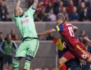 Philadelphia Union goalkeeper Rais Mbolhi (92) gets a hand on the ball for a deflection from an incoming shot by Real Salt Lake during their match at Rio Tinto Stadium in Sandy, UT on Saturday, March 14, 2015. The match ended in a 3-3 draw.