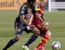 Real Salt Lake midfielder Luke Mulholland (19) is pressured for possession from Philadelphia Union midfielder Shenaon Williams (25) during their match at Rio Tinto Stadium in Sandy, UT on Saturday, March 14, 2015. The match ended in a 3-3 draw.