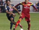 Real Salt Lake midfielder Javier Morales (11) dribbles away from Philadelphia Union midfielder Michael Lahoud (13) during their match at Rio Tinto Stadium in Sandy, UT on Saturday, March 14, 2015. The match ended in a 3-3 draw.