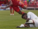 Michael Mangum  |  Special to the Tribune  Seattle Sounders defender Oniel Fisher (91) slides on the pitch as Real Salt Lake defender Demar Phillips flies over top during their match at Rio Tinto Stadium in Sandy, UT on Tuesday, June 28th, 2016.