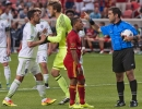 Michael Mangum  |  Special to the Tribune  Seattle Sounders goalkeeper Tyler Miller holds off teammate Herculez Gomez from referee Alex Chilowicz following Gomez's yellow card after a penalty kick was awarded during their match at Rio Tinto Stadium in Sandy, UT on Tuesday, June 28th, 2016. Joao Plata, shown, scored on the ensuing kick.