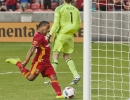 Michael Mangum  |  Special to the Tribune  Seattle Sounders goalkeeper Tyler Miller walks away in frustration as Real Salt Lake forward Joao Plata kicks the ball into the net in celebration following his penalty kick score during their U.S. Open Cup match at Rio Tinto Stadium in Sandy, UT on Tuesday, June 28th, 2016.
