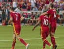 Michael Mangum  |  Special to the Tribune  Real Salt Lake players, Burrito Martinez, left, Joao Plata (10) and Yura Movsisyan celebrate Plata's successful penalty kick during their U.S. Open Cup match against the Seattle Sounders at Rio Tinto Stadium in Sandy, UT on Tuesday, June 28th, 2016.