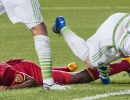 Michael Mangum  |  Special to the Tribune  Real Salt Lake defender Aaron Maund, left, and Seattle Soudners defender Zach Scott (20) both fall to the pitch after battling for the ball during their U.S. Open Cup match at Rio Tinto Stadium in Sandy, UT on Tuesday, June 28th, 2016. The match ended in a 1-1 draw with Seattle advancing after winning in a penalty kick shootout.