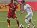 Michael Mangum  |  Special to the Tribune  Seattle Sounders midfielder Cristian Roldan (7) dribbles in front of Real Salt Lake midfielder Kyle Beckerman (5) during their U.S. Open Cup match at Rio Tinto Stadium in Sandy, UT on Tuesday, June 28th, 2016. The match ended in a 1-1 draw with Seattle advancing after winning in a penalty kick shootout.