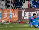 The ball hits the back of the net behind Toronto FC goalkeeper Julio Cesar (30) following a penalty kick during their match against Real Salt Lake at Rio Tinto Stadium in Sandy, UT on Saturday, March 29, 2014. Real Salt Lake defeated Toronto FC 3-0.