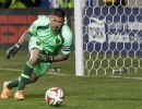 Real Salt Lake goalkeeper Nick Rimando (18) dives to stop a shot during their match against Toronto FC at Rio Tinto Stadium in Sandy, UT on Saturday, March 29, 2014. Rimando notched his 110th MLS shutout as Real Salt Lake defeated Toronto FC 3-0.
