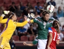 Mexico defender Alina Garciamendez (4) heads clear the ball from the goal box following a United States corner kick during the second half of their match at Rio Tinto Stadium in Sandy, UT on Saturday, September 13, 2014. United States beat Mexico 8-0.  Michael Mangum  |  ChangingMyLens.com