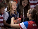 United States forward Alex Morgan signs her game cleats and gives them away to a fan after their match against Mexico at Rio Tinto Stadium in Sandy, UT on Saturday, September 13, 2014. United States beat Mexico 8-0.  Michael Mangum  |  ChangingMyLens.com