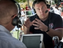 Real Salt Lake general manager Garth Lagerway, right, speaks with Keith Stubbs on ESPN 700 at the Gallivan Center in Salt Lake City before the broadcast of the United States' World Cup match against Belgium on Tuesday, July 1, 2014. The United States were knocked out of the tournament following a 2-1 loss in extra time.  Michael Mangum  |  ChangingMyLens.com
