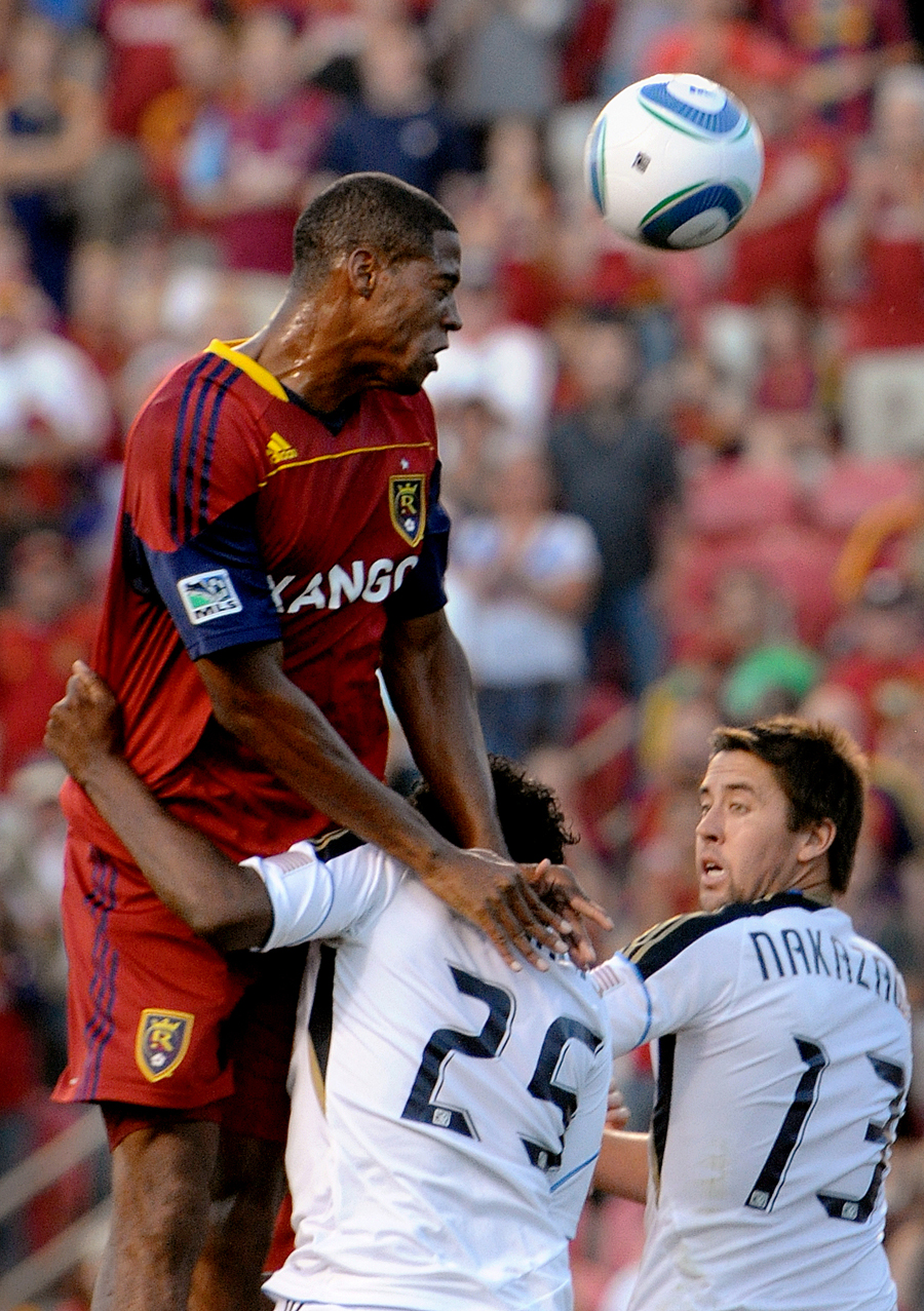 Real Salt Lake defender Chris Schuler heads in a goal over the top of Philadelphia Union's Sheanon Williams (25) and Kyle Nakazawa (13) during their match at Rio Tinto Stadium in Sandy, Utah on Saturday, September 3, 2011. | Photo by Michael Mangum