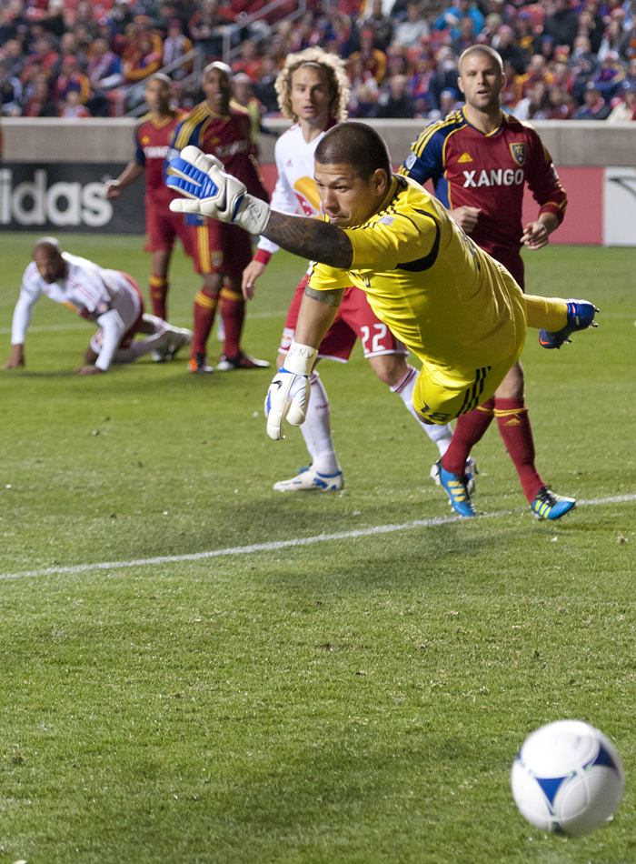 Real Salt Lake goalkeeper NICK RIMANDO (18) dives for the ball after a bicycle kick from New York forward THIERRY HENRY as Real Salt Lake hosted New York Red Bulls at Rio Tinto Stadium in Sandy, Utah on Saturday, March 17, 2012. Real Salt Lake won the game 2-0. | Photo by Michael Mangum