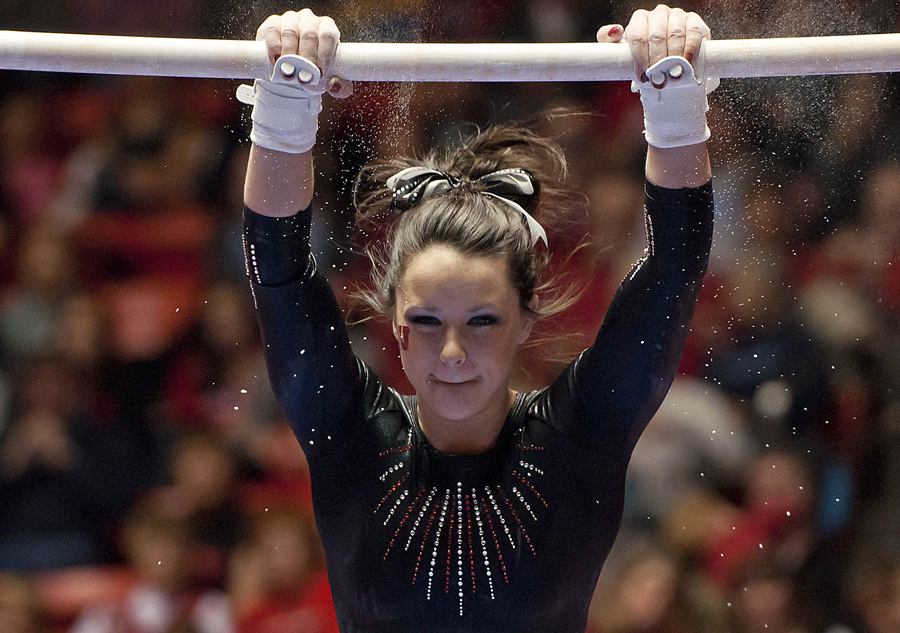 Michael Mangum  |  The Salt Lake Tribune | Utahs Stephanie McAllister performs on the uneven bars during the Red Rocks' meet against the Michigan Wolverines at the Huntsman Center in Salt Lake City on Friday, February 18, 2011.