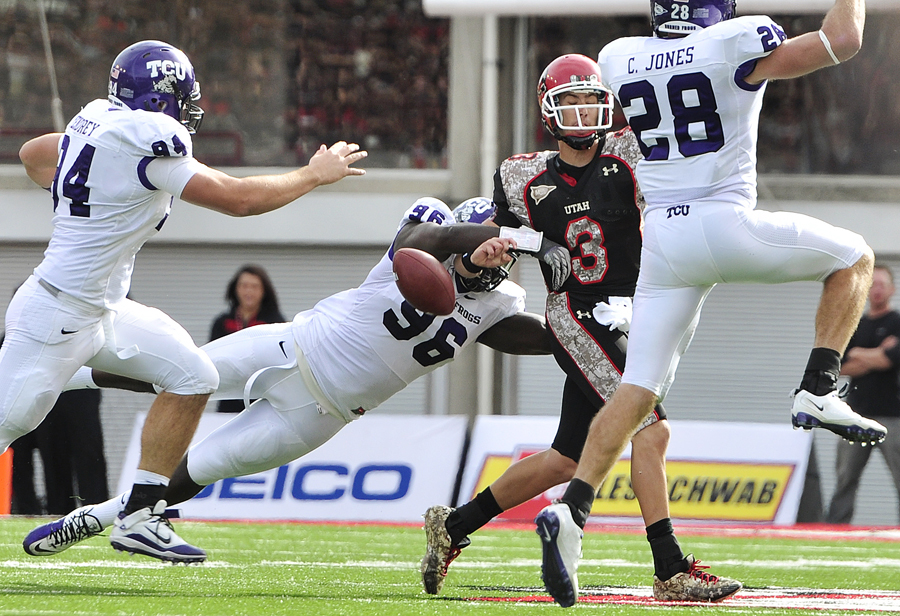 Michael Mangum | The Salt Lake Tribune | Hit by TCU defensive end Wayne Daniels (96) Utah quarterback Jordan Wynn (3) fumbles the ball during the first half of play against the Horned Frogs at Rice-Eccles Stadium in Salt Lake City on Saturday, November 6, 2010.