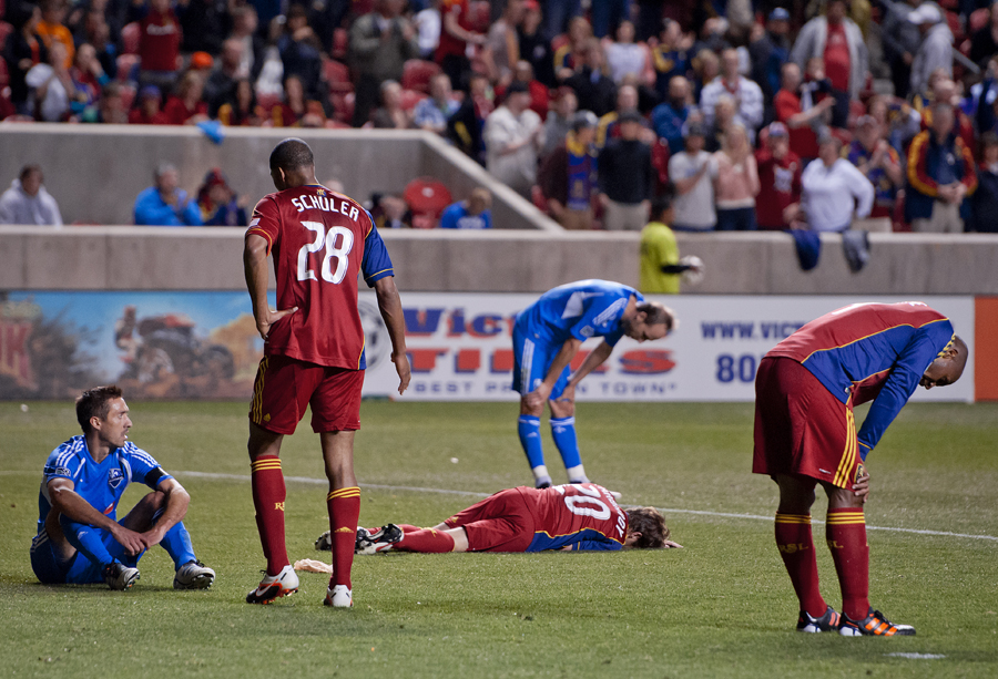Players from Real Salt Lake and Montreal Impact catch their breath after an intensely physical final few minutes of the second half of MLS action at Rio Tinto Stadium in Sandy, Utah on Wednesday, April 4, 2012. Real Salt Lake won the game 1-0. Real Salt Lake midfielder NED GRABAVOY (20) lays on the ground with what was initially thought to be a broken rib. | Photo by Michael Mangum