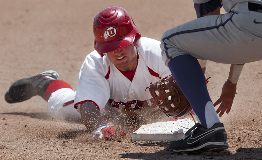 Utah center fielder PARKER MORIN (23) slides safe into third base after hitting a triple against Washington at Spring Mobile Ballpark in Salt Lake City, UT on Saturday, April 28, 2012. The Utes defeated the Huskies at home 6-0. | Photo by Michael Mangum