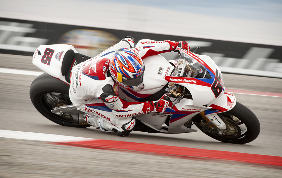 Great Britain's JONATHAN REA (65), riding a Honda CBR1000RR, rounds the turn at Knock Out corner during the Tissot-Superpole at the FIM Superbike World Championship races at Miller Motorsports Park in Grantsville, UT on Sunday, May 27, 2012. Rea qualified fifth in the superpole with a time of 1'48.563. | Photo by Michael Mangum