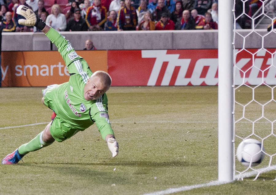 FC Dallas goalkeeper KEVIN HARTMAN dives and misses a shot on goal from Real Salt Lake during their match at Rio Tinto Stadium in Sandy, UT on Saturday, May 26, 2012. Real Salt Lake defeated FC Dallas 3-2 on a stoppage time goal. | Photo by Michael Mangum