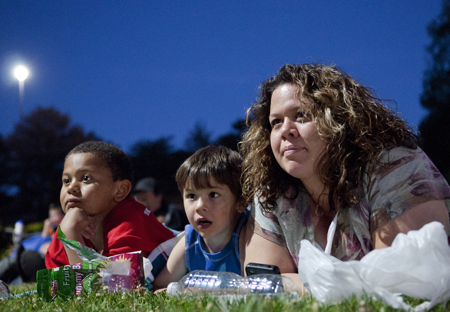Michael Mangum  |  Special to the Tribune  |  Holladay resident Martha Gladue, right, and her sons Peyton, 4, center, and Roman, 8, lay on the grass and watch Toy Story at Salt Lake City's Friday Night Flicks in Liberty Park on Friday, June 1, 2012. Friday Night Flicks will have 7 engagements this summer, and will be held in various Salt Lake City parks on Friday evenings.