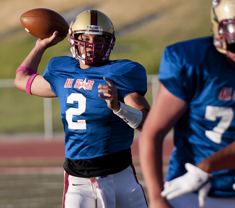 Michael Mangum  |  Special to the Tribune  |  Logan quarterback DJ Nelson (2) loads up for a throw during the first half of play of the Utah High School Coaches Association 4A/5A all-star football game at Alta High School on Saturday, June 23, 2012. The South all stars led the North all stars 12-3 at the end of the first half.
