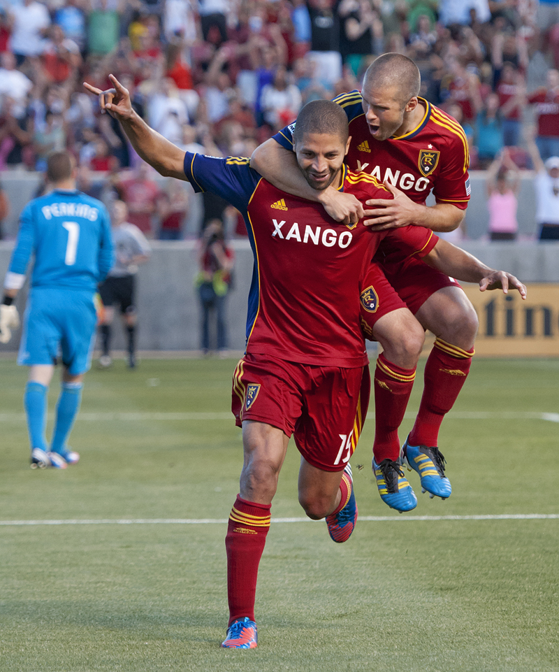 Real Salt Lake defender CHRIS WINGERT (17) leaps on the back of forward ALVARO SABORIO (15) after Saborio was successful on a penalty kick during their match at Rio Tinto Stadium in Sandy, UT on Saturday, July 7, 2012. Real Salt Lake shut out Portland 3-0 on a hat trick from Saborio. Photo by Michael Mangum