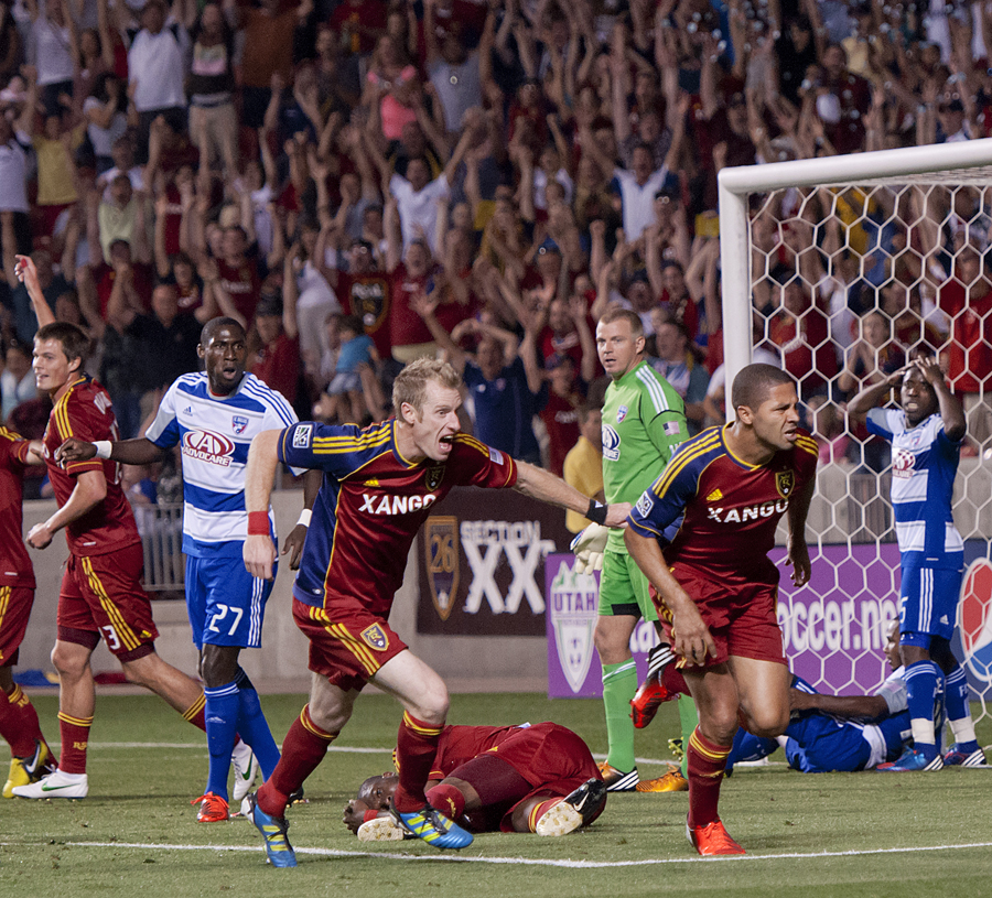 REAL SALT LAKE forward ALVARO SABORIO (15), second from right, and defender NAT BORCHERS, center, celebrate Saborio's game-tying goal against FC Dallas during their match at Rio Tinto Stadium in Sandy, UT on Saturday, August 18, 2012. FC Dallas defeated Real Salt Lake 2-1 on a stoppage time game-winning goal. | Photo by Michael Mangum